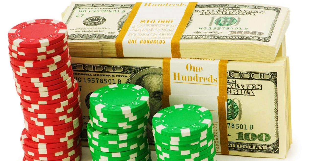 Casino bonus chips staked in front of a stack of dollar bills
